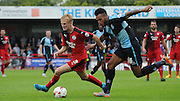 Christian Scales burst past Aaron Amadi-Holloway during the Sky Bet League 2 match between Crawley Town and Wycombe Wanderers at the Checkatrade.com Stadium, Crawley, England on 29 August 2015. Photo by Michael Hulf.