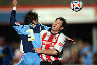Clint Easton left for Wycombe, Steve Guinan for Cheltenham<br /> <br /> Photo: Richard Eaton.<br /> <br /> Cheltenham Town v Wycombe Wanderers. Coca Cola League 2. 04/03/2006.