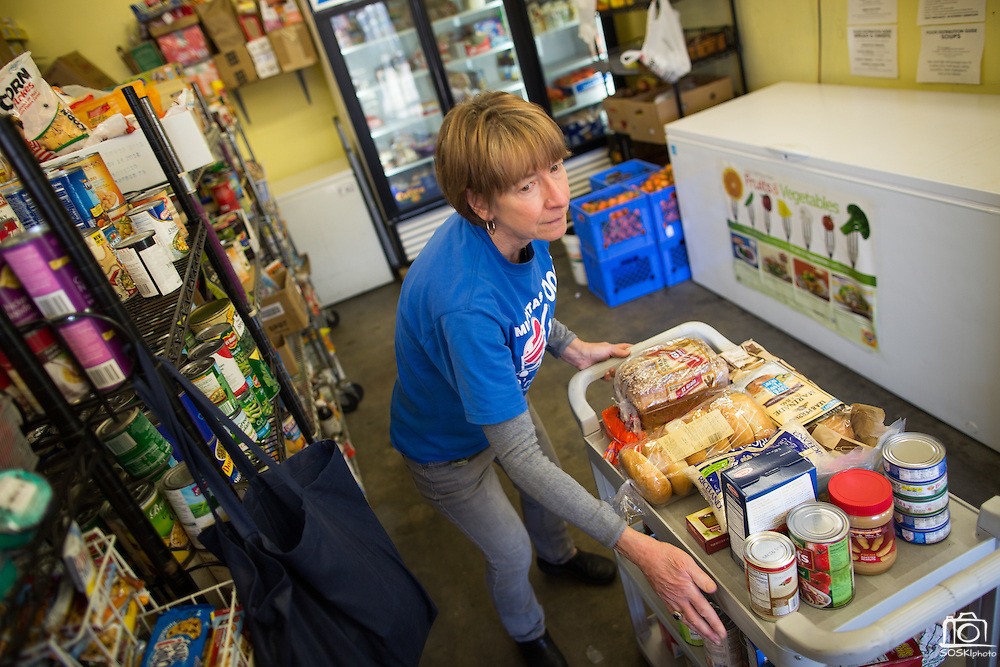 Program Assistant Ellen Brutsch prepares monthly groceries for beneficiaries at the Milpitas Food Pantry in Milpitas, California, on November 25, 2014. (Stan Olszewski/SOSKIphoto)