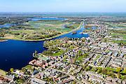 Nederland, Noord-Holland, regio Waterland, 20-04-2015; Landsmeer, met de dorpsstraat Noordeinde en de Kerkebreek, onderdeel natuurgebied het Twiske. Het dorp maakt deel uit van de  Stadsregio Amsterdam (plusregio). <br /> Landsmeer, village north of Amsterdam.<br /> luchtfoto (toeslag op standard tarieven);<br /> aerial photo (additional fee required);<br /> copyright foto/photo Siebe Swart