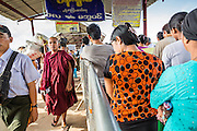 "17 JUNE 2013 - YANGON, MYANMAR:  Passengers get off in Dala (on the left) and line up to get to go Yangon on (on the right) the Dala-Yangon Ferry across the Yangon River. The ferry to Dala opposite Yangon on the Yangon River is the main form of transportation across the river. Every day the ferry moves tens of thousands of people across the river. Many working class Burmese live in Dala and work in Yangon. The ferry is also popular with tourists who want to experience the ""real"" Myanmar. The rides takes about 15 minutes. Burmese pay about the equivalent of .06¢ US for a ticket.  Foreigners pay about the equivalent of about $4.50 US for the same ticket.    PHOTO BY JACK KURTZ"