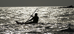 © under license to London News Pictures.  19/03/2011  A canoeist is silhouetted against the evening sun in the sea at Wembury beach, Devon, after a day of sun and warm temperatues. Picture credit sould read: David Hedges/LNP