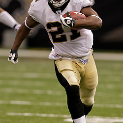 2009 September 13: New Orleans Saints running back Mike Bell (21) runs with the ball during a 45-27 win by the New Orleans Saints over the Detroit Lions at the Louisiana Superdome in New Orleans, Louisiana.