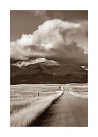 Road on the Montana plains near the Rocky Mountain Front Ranges of Glacier National Park USA
