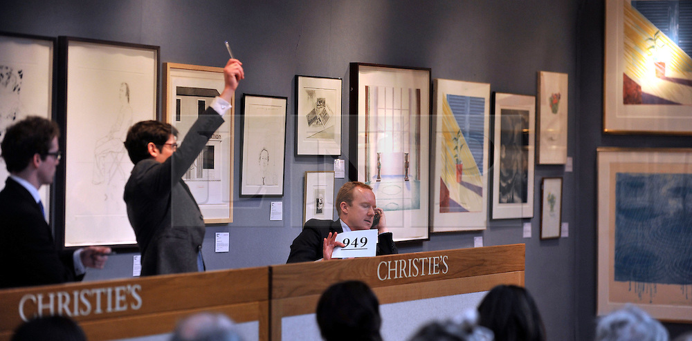 © Licensed to London News Pictures. 17/02/2012, London, UK. A member of staff takes a bid via telephone. An auction of items by British artist David Hockney takes place at Christie's in London's South Kensington today, 17th February 2012. It features over 100 works by Hockney, including etchings, lithographs, drawings and photography. They are expected to sell for over £1m. The sale spans over 40 years of Hockney's career. Photo credit : Stephen Simpson/LNP
