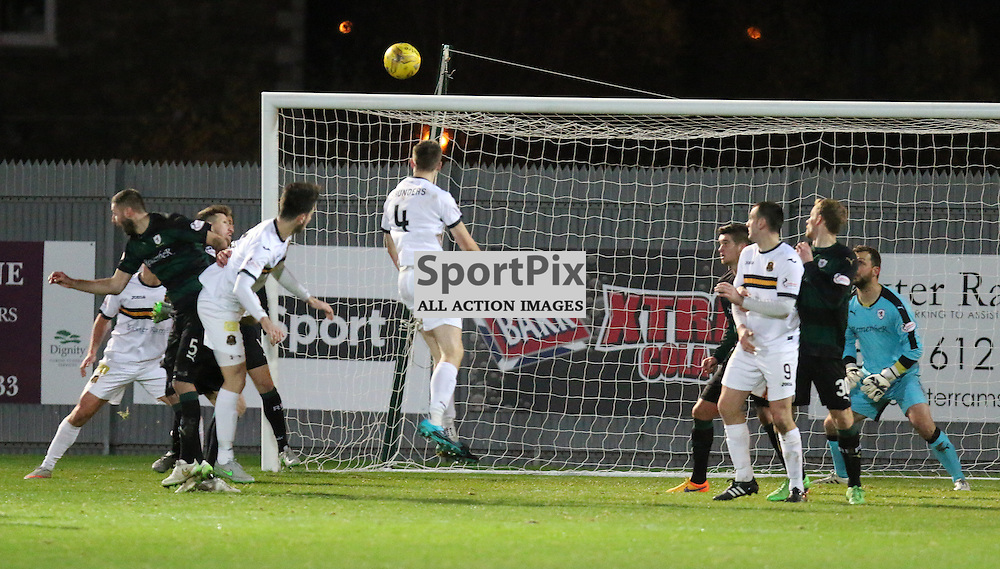 Steven Saunders rises high to score 2 sons goals during the Dumbarton v Raith Rovers Scottish Championship 21  November 2015 <br /> <br /> (c) Andy Scott | SportPix.org.uk