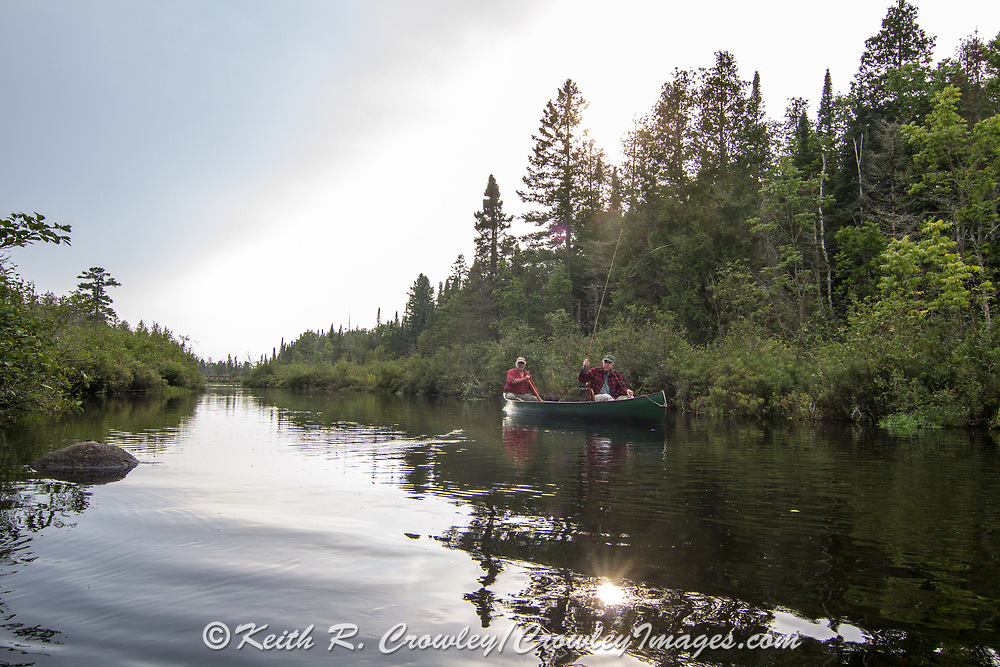 Brule River fishing guide Damian Wilmot (left) fishes with angler Matson Holbrook in a 1895 Joe Lucius guide canoe Wilmot meticulously restored over the course of two years.