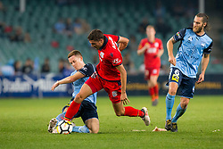 April 8, 2018 - Sydney, NSW, U.S. - SYDNEY, NSW - APRIL 8: Sydney FC midfielder Brandon O'Neill (13) slides to tackle Adelaide United forward George Blackwood (14) at the A-League Soccer Match between Sydney FC and Adelaide United on April 8, 2018 at Allianz Stadium in Sydney, Australia. (Photo by Speed Media/Icon Sportswire) (Credit Image: © Speed Media/Icon SMI via ZUMA Press)