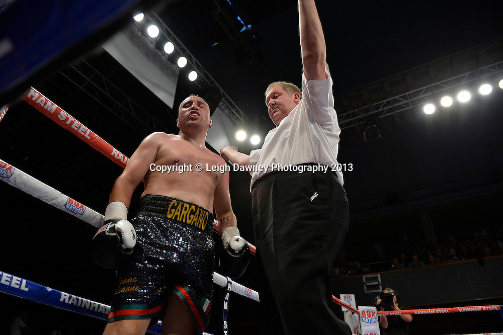 Ricky Summers defeats Curtis Gargano after referee Terry O'Connor counts him out in a Light Heavyweight contest at Wolverhampton Civic Hall, Wolverhampton, 1st August 2014. Frank Warren in association with PJ Promotions.  © Credit: Leigh Dawney Photography.