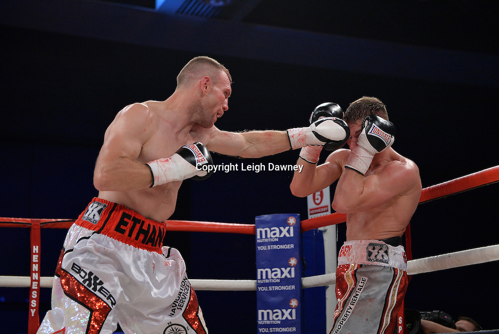 Nick Blackwell defeats Nathan King (left) in a middleweight boxing contest at Glow, Bluewater, Kent on the 8th November 2014. Promoter: Hennessy Sports. © Leigh Dawney Photography 2014.