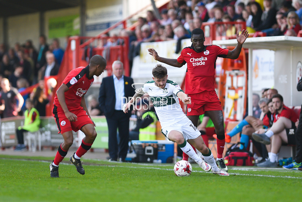 Plymouth Argyle midfielder Matthew Kennedy (16) keeps possession under pressure from Crawley Town midfielder Enzio Boldewijn (7) during the EFL Sky Bet League 2 match between Crawley Town and Plymouth Argyle at the Checkatrade.com Stadium, Crawley, England on 8 April 2017. Photo by David Charbit.