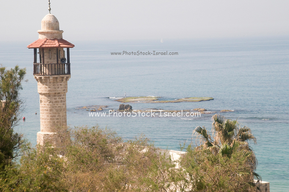 Israel, Jaffa, The turret of El Baher mosque and the Andromeda rock at the entrance to the harbour in the background. Andromeda was a woman from Greek mythology who was chained to a rock to be a sacrifice to a sea monster as divine punishment for her mother's bragging. She was saved from death by Perseus