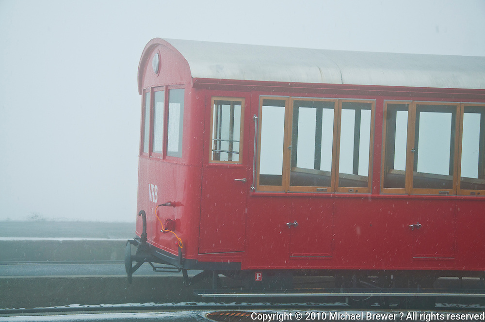 Mt. Rigi, Central Switzerland. The cogwheel train with an older, red, carriage in the snow.