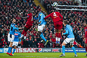 Liverpool forward Sadio Mane (10), Napoli defender Kalidou Koulibaly (26) and Liverpool defender Virgil van Dijk (4) in action during the Champions League match between Liverpool and Napoli at Anfield, Liverpool, England on 27 November 2019.