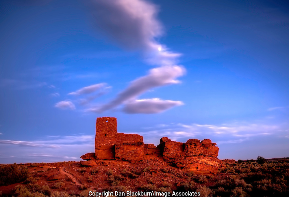 The Moon Peeks Through the Clouds Over Wukoki Pueblo at Sunset in Wupatki National Monument Arizona