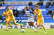 Preston North End striker Tom Barkhuizen (29) and Reading midfielder Yakou Meite (19) during the EFL Sky Bet Championship match between Reading and Preston North End at the Madejski Stadium, Reading, England on 7 April 2018. Picture by Alistair Wilson.
