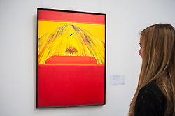 "© Licensed to London News Pictures. 02/10/2015. London, UK. A Sotheby's employee views ""Unititled, (Bird, Tree and Mountain)"" by Jagdish Swaminathan (est. £60k - 80k) at the preview of Indian and Islamic Art Week at Sotheby's which runs from 2 to 7 October.  Photo credit : Stephen Chung/LNP"