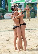 STARE JABLONKI POLAND - July 5: Doris Schwaiger /1/ and Stefanie Schwaiger of Austria in action during Day 5 of the FIVB Beach Volleyball World Championships on July 5, 2013 in Stare Jablonki Poland.  (Photo by Piotr Hawalej)