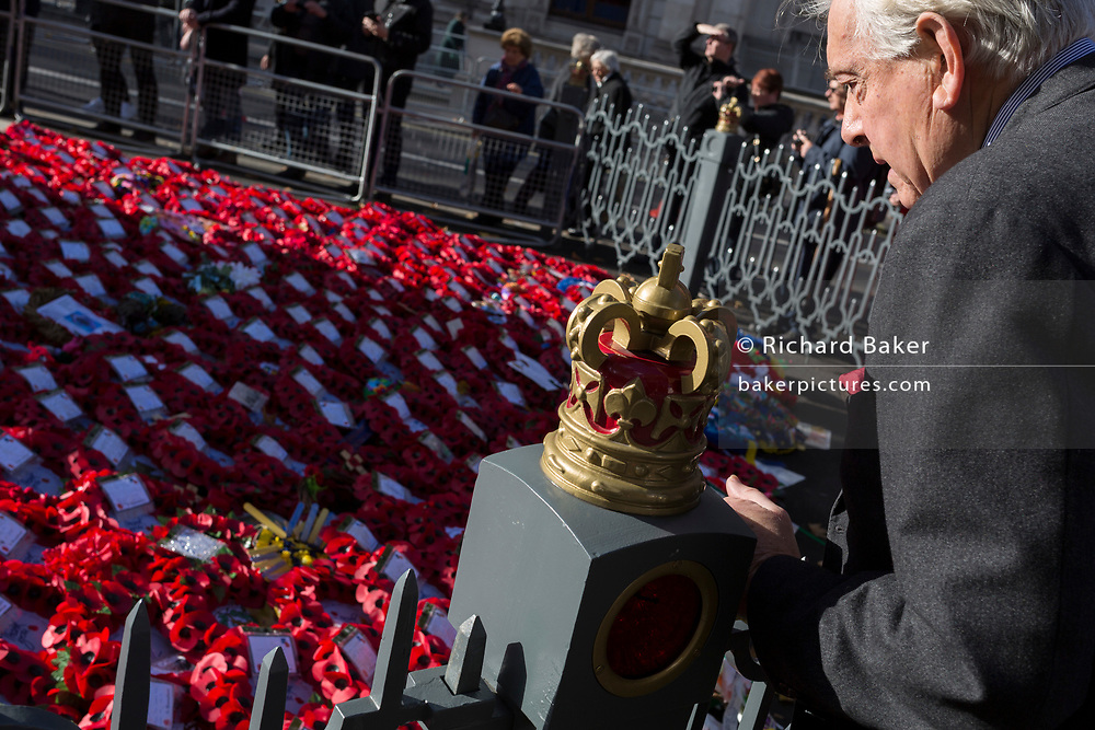 Visitors to the Cenotaph in Whitehall pay their respects to those killed in war and conflict, where wreaths were left 2 two days after Remembrance Sunday which commemorated the 100th anniversary of the WW1 armistice, on 13th November 2018, in London, England.