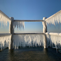 ice on the railing by the bay in The North Fork of Long Island