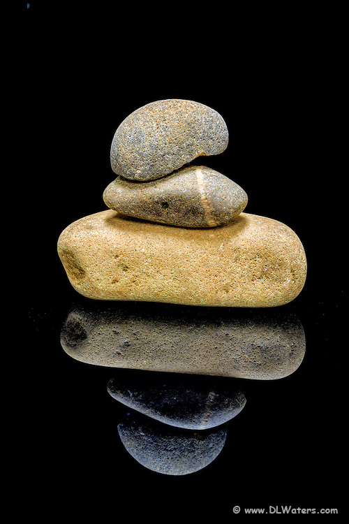 A zen pile of rocks and reflection.