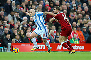 Aaron Mooy of Huddersfield Town looks to get away from Jordan Henderson of Liverpool. Premier League match, Liverpool v Huddersfield Town at the Anfield stadium in Liverpool, Merseyside on Saturday 28th October 2017.<br /> pic by Chris Stading, Andrew Orchard sports photography.
