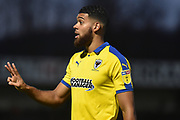 AFC Wimbledon striker (on loan from Luton Town) Jake Jervis (10) shows the linesman the number of fouls committed on AFC Wimbledon striker Kwesi Appiah (9) during the EFL Sky Bet League 1 match between Wycombe Wanderers and AFC Wimbledon at Adams Park, High Wycombe, England on 22 December 2018.