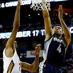 Dec 5, 2016; New Orleans, LA, USA; Memphis Grizzlies guard Wade Baldwin IV (4) shoots over New Orleans Pelicans center Alexis Ajinca (42) during the second quarter of a game at the Smoothie King Center. Mandatory Credit: Derick E. Hingle-USA TODAY Sports