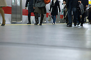 people going to work walking train station Japan Tokyo