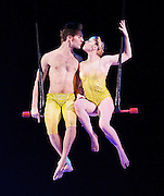 TOTEM<br /> Cirque du Soleil<br /> at The Royal Albert Hall, London, Great Britain <br /> 4th January 2012 <br /> Dress rehearsal <br /> <br /> Hoops Dancer<br /> Nakotah Larance<br /> <br /> Fixed Trapeze Duo<br /> Louis-David Simoneau<br /> Rosalie Ducharme<br /> <br /> Manipulation<br /> Greg Kennedy <br /> <br /> Roller Skates<br /> Massimiliano Medini<br /> Denise Garcia-Sorta<br /> <br /> TOTEM traces the fascinating journey of the human species from its original amphibian state to its ultimate desire to fly. The characters evolve on a stage evoking a giant turtle, the symbol of origin for many ancient civilizations.<br /> <br /> Inspired by many founding myths, TOTEM illustrates, through a visual and acrobatic language, the evolutionary progress of species.<br /> <br /> Somewhere between science and legend TOTEM explores the ties that bind Man to other species, his dreams and his infinite potential.<br /> <br /> <br /> <br /> Photograph by Elliott Franks