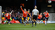 Luke Wilkinson of Luton Town (centre) celebrates scoring the opening goal against Newport County during the Sky Bet League 2 match at Kenilworth Road, Luton<br /> Picture by David Horn/Focus Images Ltd +44 7545 970036<br /> 20/12/2014