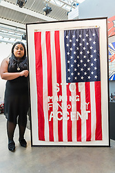 "Licensed to London News Pictures. 06/10/2016. London, UK. Artist, Marium M Habib, from Karachi, Pakistan, shows her work ""Stop Making Fun of My Accent"" at the preview of Moniker Art Fair, part of London Art Week, taking place at the Old Truman Brewery, near Brick Lane.  Now in its seventh year, the fair embraces contemporary art from emerging and established artists, the majority of whom attend the fair in person in order to meet potential collectors and to show their work. Photo credit : Stephen Chung/LNP"