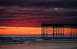 © Licensed to London News Pictures. <br /> 07/04/2017<br /> Saltburn-by-the-Sea, UK. <br />  <br /> Clouds reflect the sunlight as the sun begins to rise at Saltburn-by-the-Sea in North Yorkshire. <br /> <br /> <br /> Photo credit: Ian Forsyth/LNP