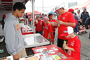 ANAHEIM, CA - APRIL 22:  Los Angeles Angels of Anaheim fans have fun looking at memorabilia at FanFest before the game against the Baltimore Orioles on Sunday, April 22, 2012 at Angel Stadium in Anaheim, California. The Orioles won the game 3-2 in ten innings. (Photo by Paul Spinelli/MLB Photos via Getty Images)
