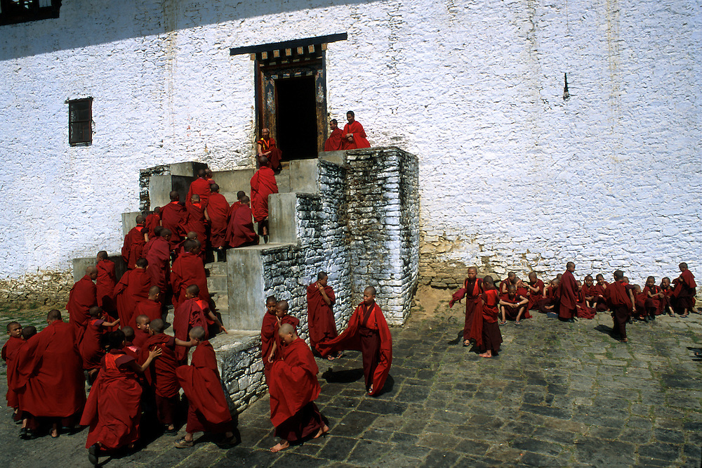 BHUTAN: Semtokha.Novice monks at Semtokha Monastery return indoors to classes after a breath of fresh air