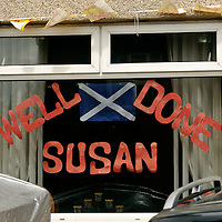 Britain's Got Talent runner up Susan Boyle flew into Edinburgh airport last night. Neighbors in her home town Blackburn, West Lothian put out flags and banners welcoming her home. On Sunday 7th June 2009 a man and a woman came to pick up her cat Pebbles from her home...Picture shows messages of support in one neighbors window.