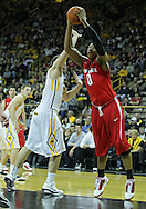 January 04 2010: Ohio State Buckeyes forward Jared Sullinger (0) puts up a shot past Iowa Hawkeyes forward Andrew Brommer (20) during the second half of an NCAA college basketball game at Carver-Hawkeye Arena in Iowa City, Iowa on January 04, 2010. Ohio State defeated Iowa 73-68.