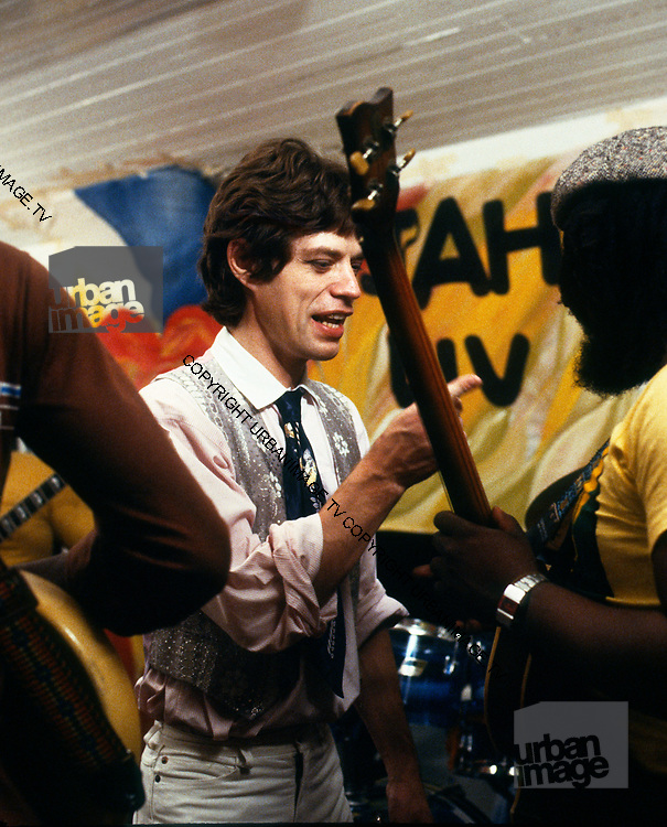 Mick Jagger and Peter Tosh with the Rolling Stones during the Don't Look Back video shoot - Strawberry Hill Jamaica 1978.