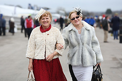 © Licensed to London News Pictures. 08/04/2016. Liverpool, UK. Two smartly dressed women enjoy Ladies Day at the Grand National 2016 at Aintree Racecourse near Liverpool. The race, which was first run in 1839, is the most valuable jump race in Europe. Photo credit : Ian Hinchliffe/LNP