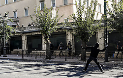 Protesting student throw a rock to riot police during a protest against newly announced educational reforms and the lifting of the universities asylum, in Athens, Greece on October 24, 2019<br /> <br /> Pictured: <br /> Dimitris Lampropoulos  | EEm date