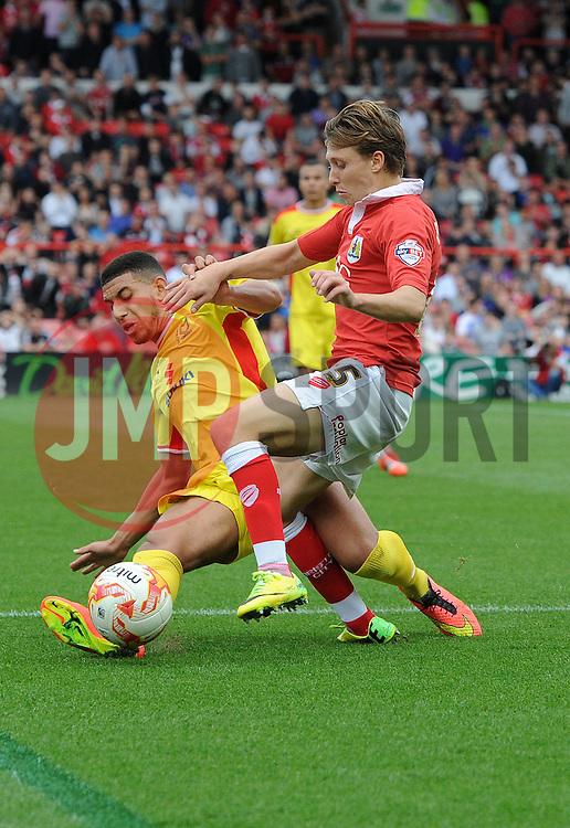 Milton Keynes Dons' Samir Carruthers tackles Bristol City's Luke Freeman - Photo mandatory by-line: Joe Meredith/JMP - Mobile: 07966 386802 - 27/09/2014 - SPORT - Football - Bristol - Ashton Gate - Bristol City v MK Dons - Sky Bet League One