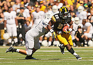 September 21 2013: Iowa Hawkeyes running back LeShun Daniels (29) is hit by Western Michigan Broncos linebacker Kyle Lark (40) during the third quarter of the NCAA football game between the Western Michigan Broncos and the Iowa Hawkeyes at Kinnick Stadium in Iowa City, Iowa on September 21, 2013. Iowa defeated Western Michigan 59-3.