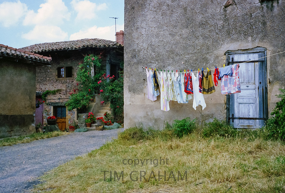 Domestic scene of laundry on washing line in village of Chenas, France