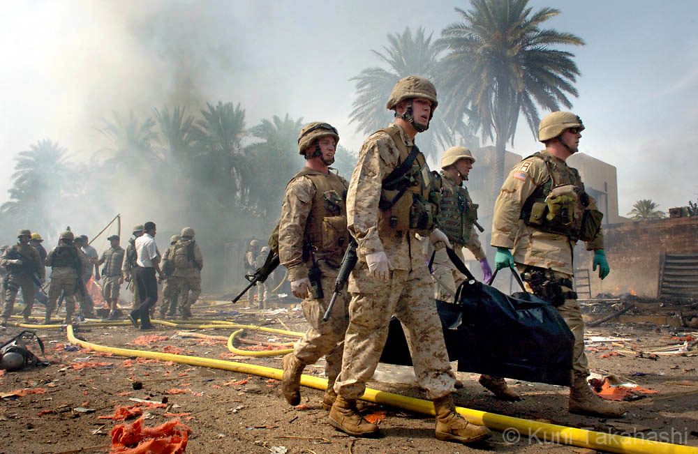 The U.S soldiers carry a body bag after bomb attacks in International Zone (Green Zone) in downtown Baghdad.