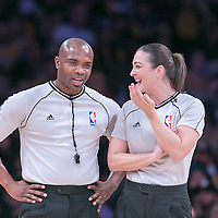 16 November 2014: NBA referee Courtney Kirkland talks to Lauren Holtkamp during the Golden State Warriors 136-115 victory over the Los Angeles Lakers at the Staples Center, Los Angeles, California, USA.