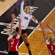26 August 2016: The San Diego State Aztecs took on the Marist Red Foxes to open up the season.  OH Alexis Cage (18) spikes the ball in the first set. The Aztecs swept the Red Foxes 3-0 in their opening match of the Aztec Invitational at Peterson Gym on the campus of SDSU. www.sdsuaztecphotos.com