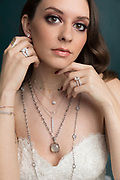 Closeup of a bride wearing jewelry for a bridal shoot for 417 bride magazine.