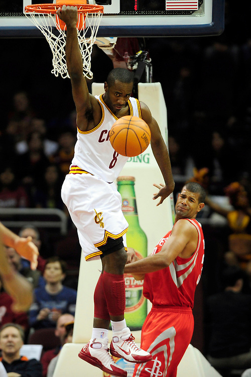 Feb. 23, 2011; Cleveland, OH, USA; Cleveland Cavaliers guard Christian Eyenga (8) dunks over Houston Rockets small forward Shane Battier (31) during the first quarter at Quicken Loans Arena. Mandatory Credit: Jason Miller-US PRESSWIRE