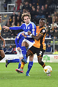 Brett Pitman of Ipswich Town and Hull City midfielder Moses Odubajo during the Sky Bet Championship match between Hull City and Ipswich Town at the KC Stadium, Kingston upon Hull, England on 20 October 2015. Photo by Ian Lyall.