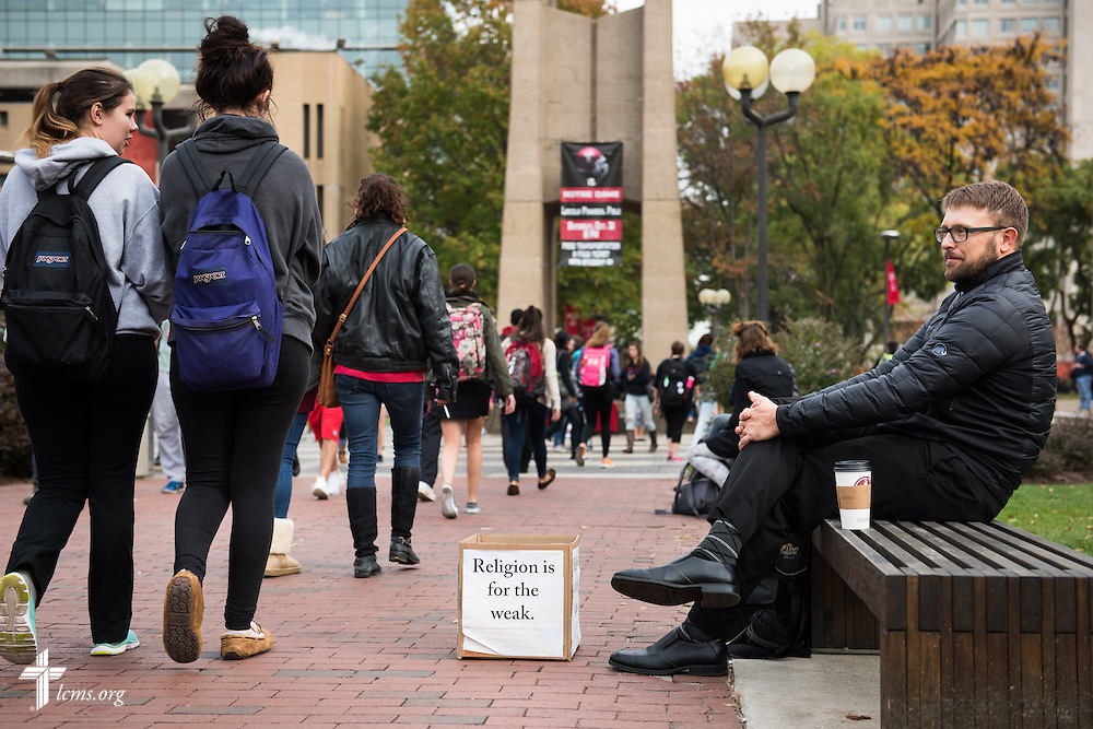 The Rev. Adam DeGroot, new national missionary and pastor at Shepherd of the City Lutheran Church, a church plant and focus of Philadelphia Lutheran Ministries, waits for students to engage him at Temple University on Monday, Nov. 2, 2015, in Philadelphia.  LCMS Communications/Erik M. Lunsford